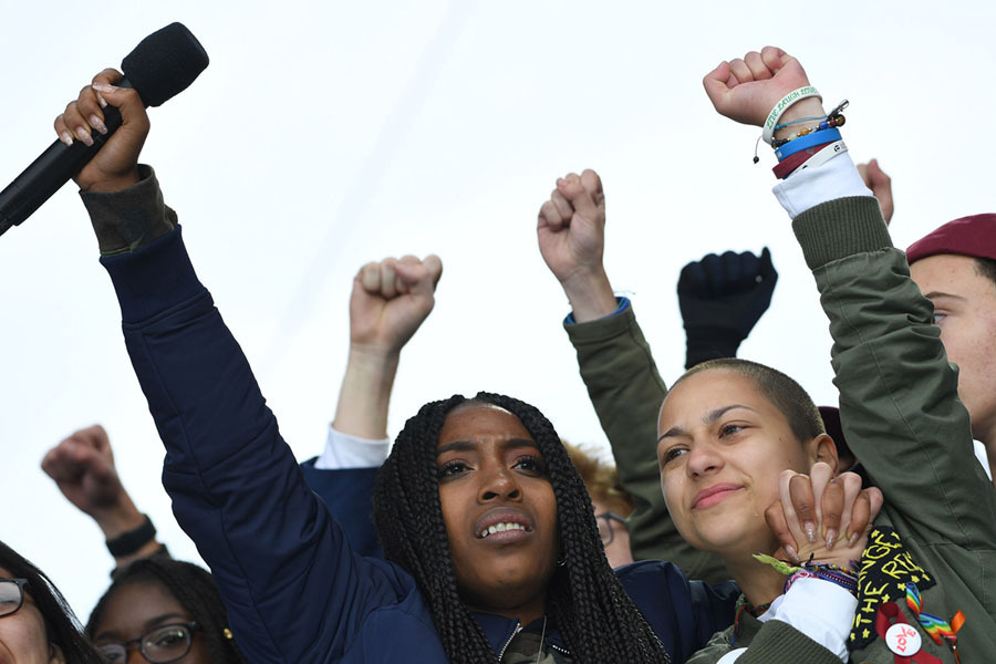 Washington, DC /    Jim Watson / AFP / Getty /  BUZZFEED :Marjory Stoneman Douglas High School student Emma Gonzalez (right) cheers with other students during the March for Our Lives rally in Washington on March 24, 2018.