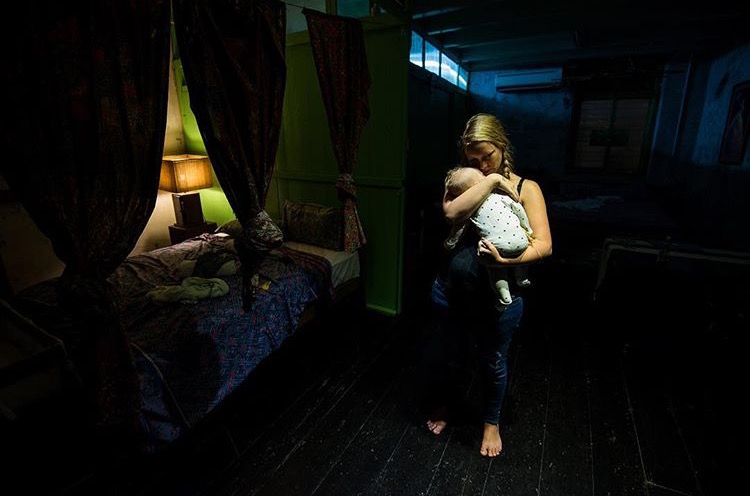 Laci Hill in dark with baby.jpg