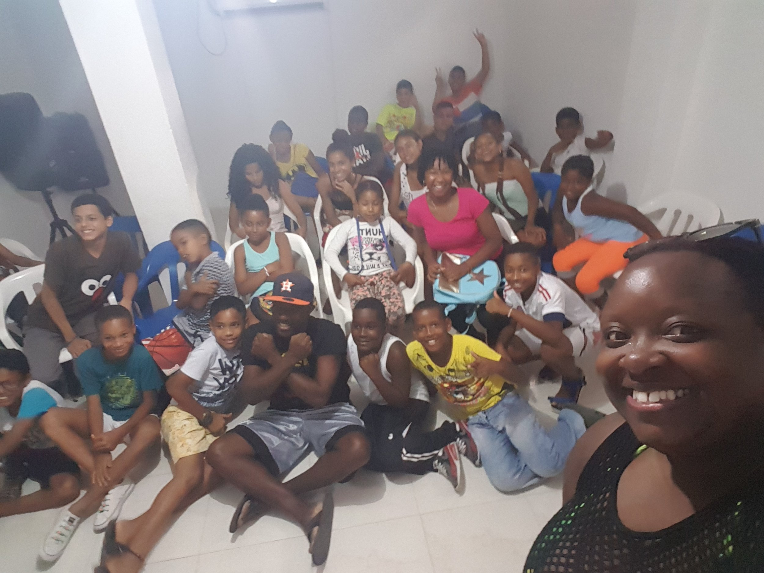Sorry for the blur....But these are the kiddies with Alex at his Community Centre....as you can see I'm wearing my swimsuit and mesh cover up!! Smh.....