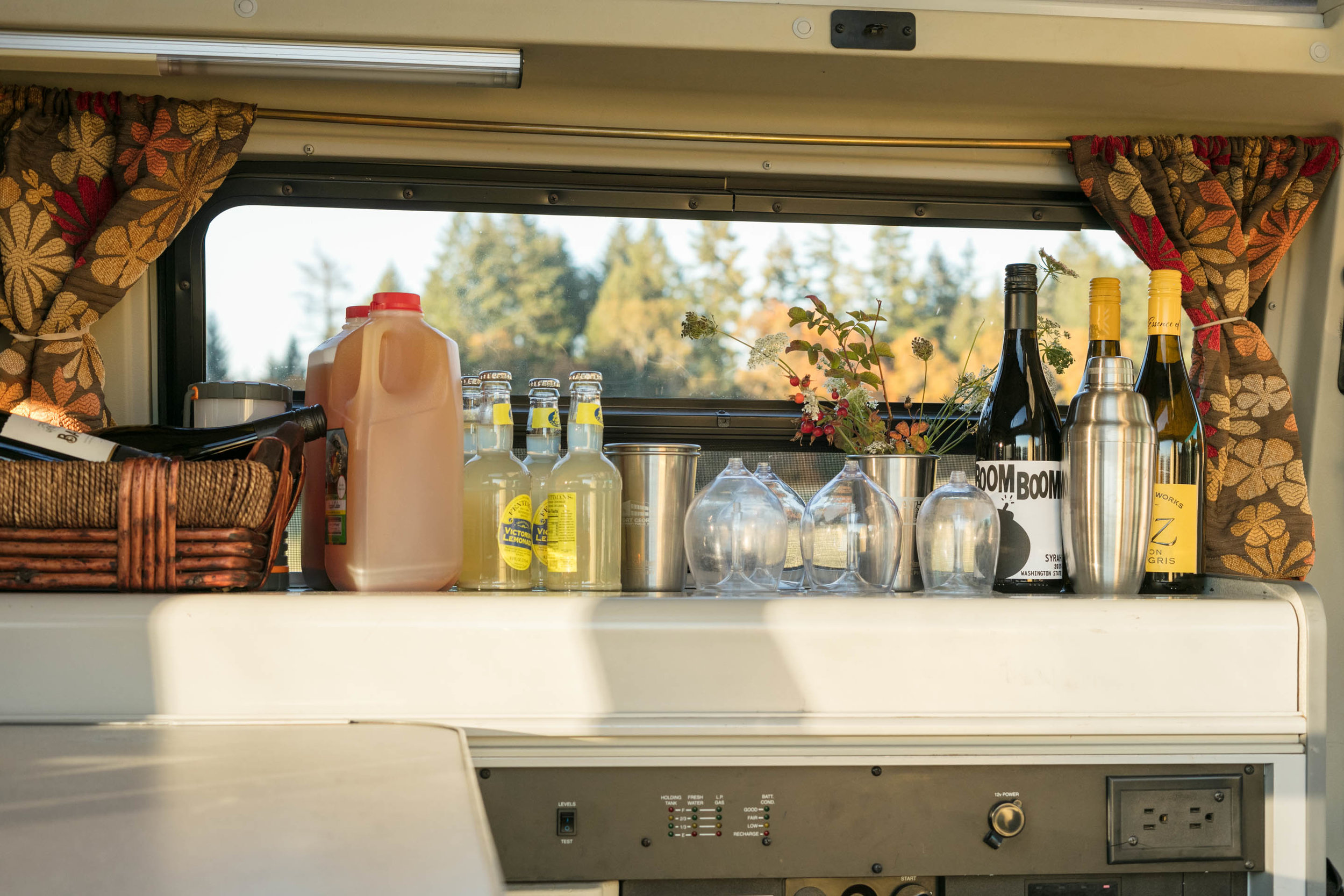 STEP 2: SET UP A BAR  in one of your rented vans. This is the Rogue, a Eurovan Camper. We used the cover of the sink and stove to create a horizontal surface. Worked like a charm.
