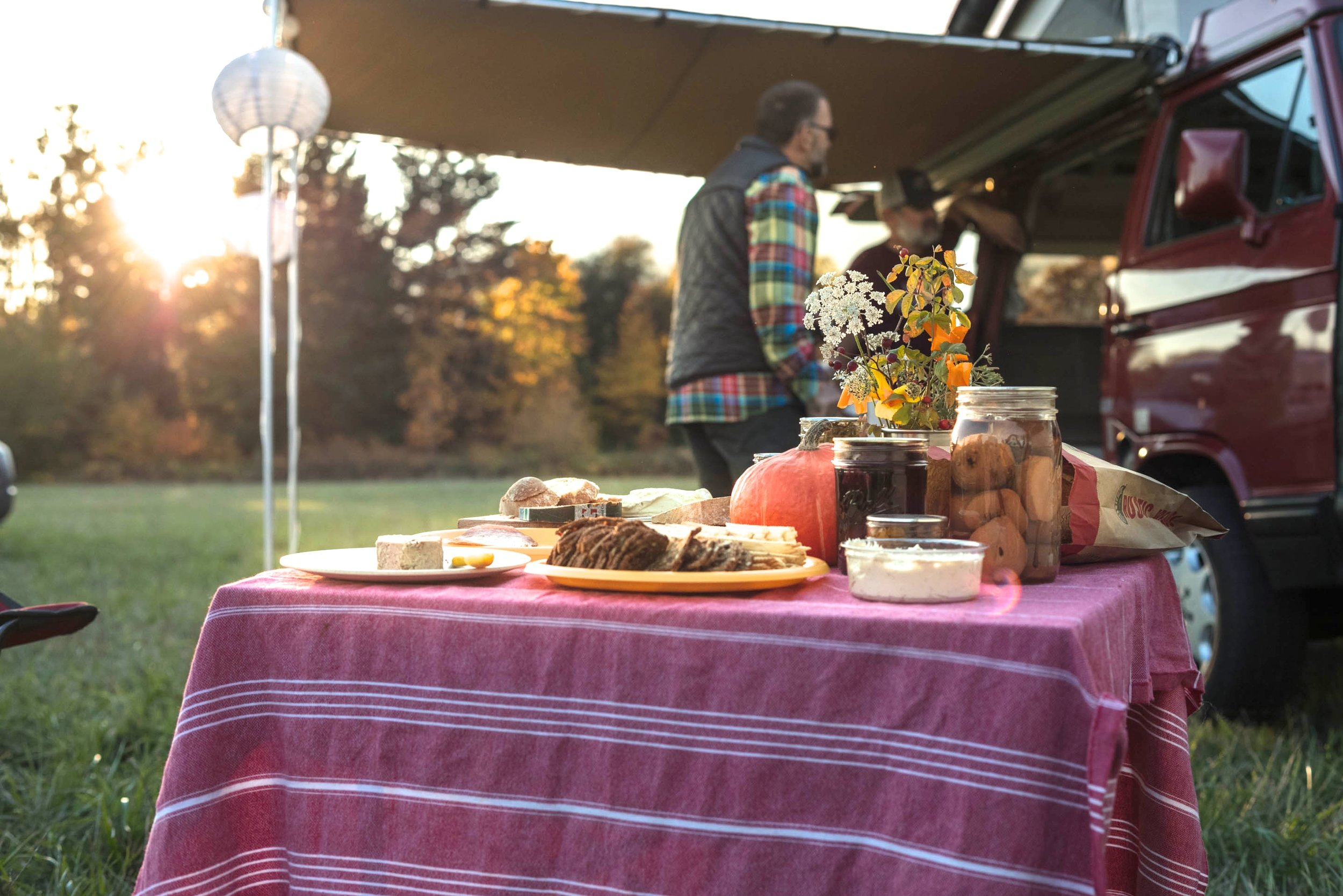 STEP 4: PUT OUT APPETIZERS . GoCamp vans all have camp tables and table cloths. Bring a few special items from your own pantry, stop for fancy cheeses on the way out of town, and voila, appetizers!