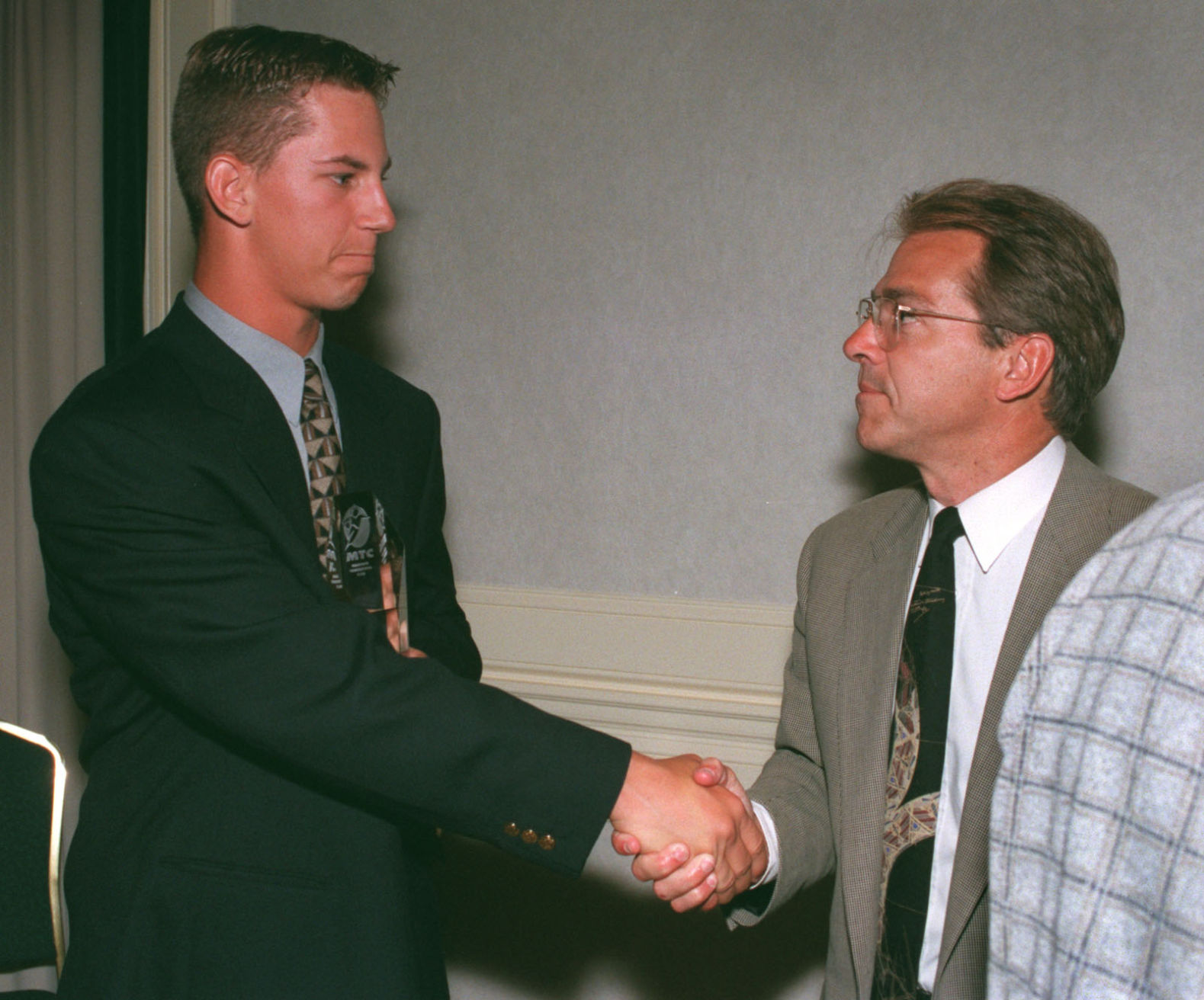 Jeff in 1999 shaking hands with the governor himself, Nicky Saban