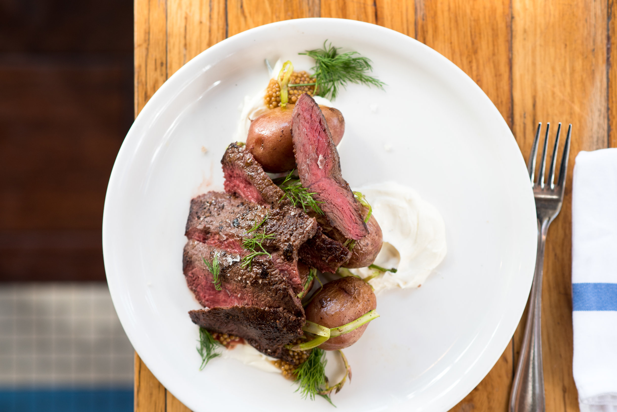 The Copper Onion Snake River Farms Pub Steak with red potatoes, shaved asparagus, horseradish, creme fraiche, pickled mustard seeds.jpg