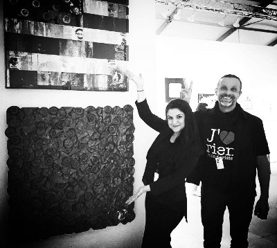 """Neda having a great time leading VIP patron tours for her Client  SCOPE International Contemporary Art Show  during Miami Art Week. She is pictured here with Artist Sebastian """"MrD""""   Boileau and his work. Peace!"""