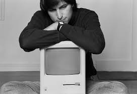 Steve Jobs with the first Macintosh computer