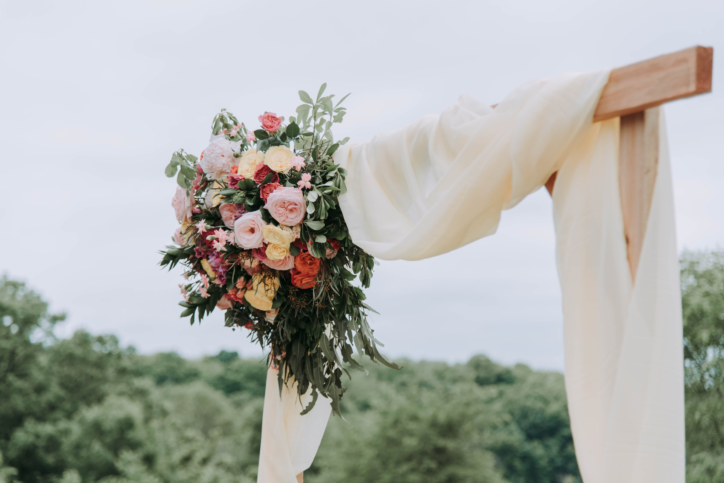 Flower Installations - Ask any photographer and they'll tell you that flowers will make all the difference at your wedding. They can make any dress or room pop in just the right way. Get yourself on Pinterest and find something you love and see what your florist can do.