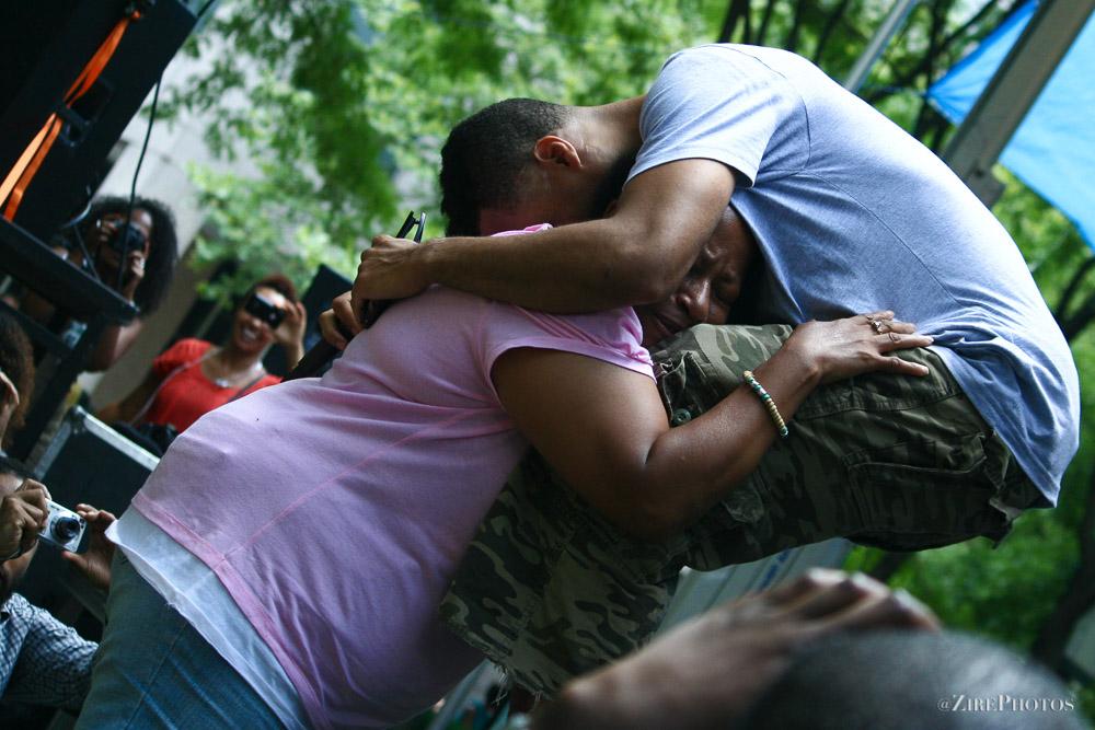 Bilal Gives A Fan A Hug