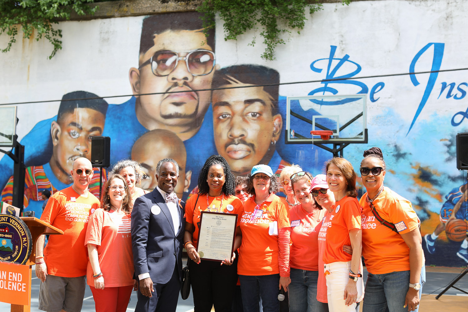 City Council President Andre Wallace Presents The Resolution Certificate To Nadine McKenzie, Amy Stern, And The Moms Demand Action Team at The Gun Violence Awareness Week at Heavy D Memorial Park in Mount Vernon June 9, 2019. PPhotography by Tyrone Z. McCants / Zire Photography