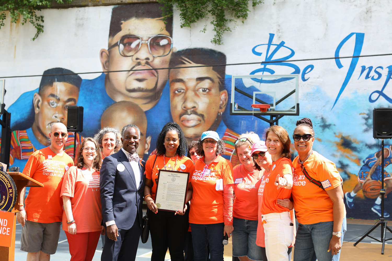 City Council President Andre Wallace Presents The Resolution Certificate To Nadine McKenzie, Amy Stern, And The Moms Demand Action Team at The Gun Violence Awareness Week at Heavy D Memorial Park in Mount Vernon June 9, 2019. Photography by Tyrone Z. McCants / Zire Photography