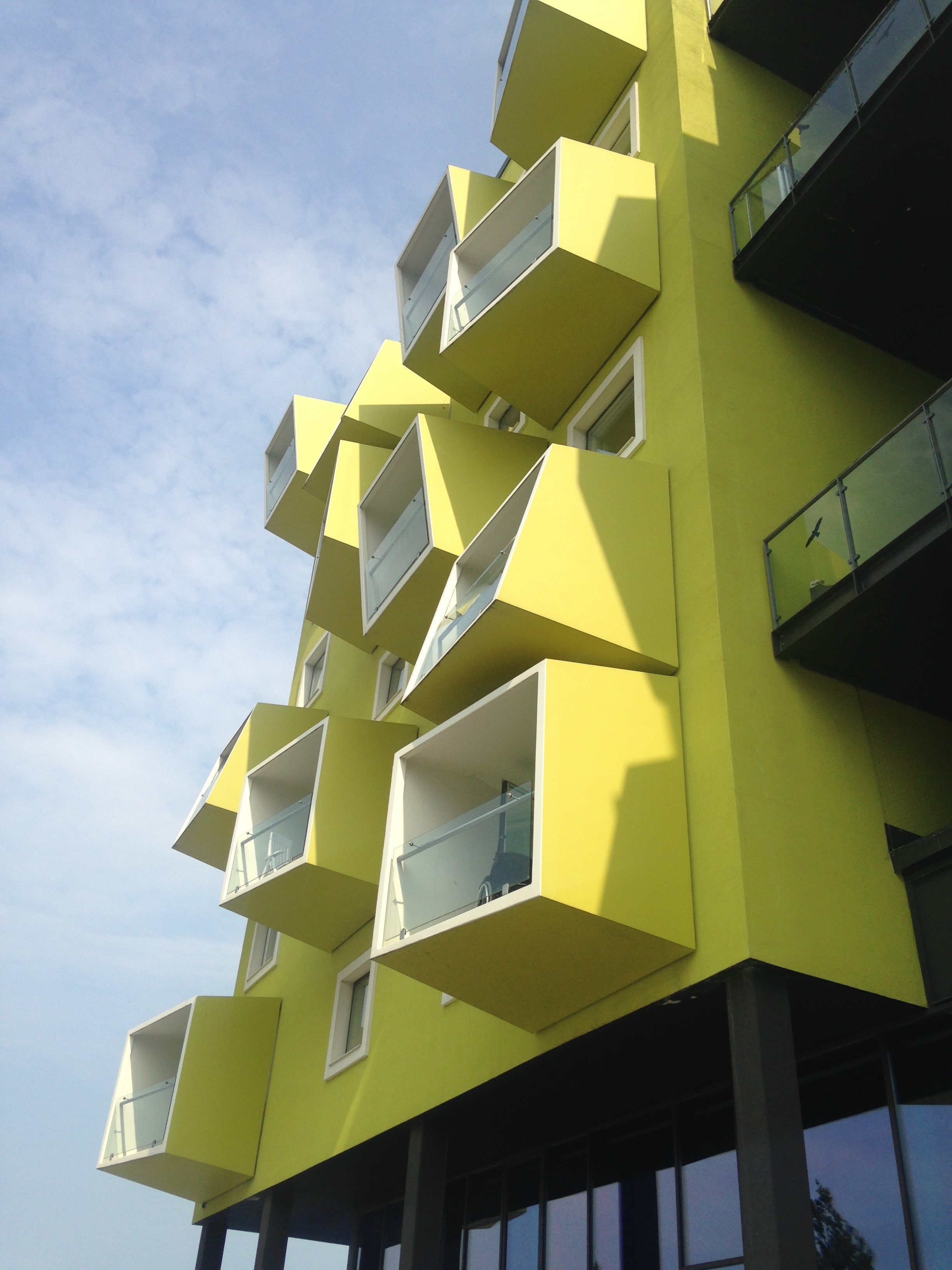 Busy but sheltered cantilevers on older people's housing