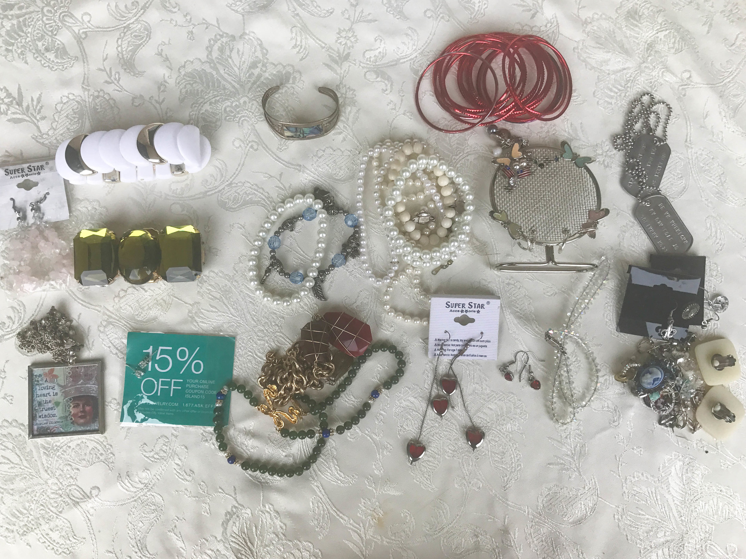 This is everything that I am getting rid of. Many of the earrings on the bottom right don't have matches so many of those will be thrown away. As for the things in good order I will try to donate those.