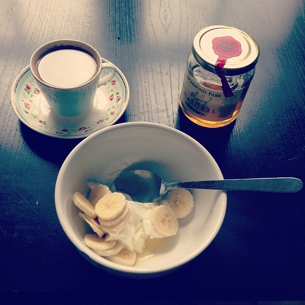 Breakie .   Coffee in my pretty @cath_kidston cup & saucer off @madebyothers. Sliced banana, Greek yoghurt and a drizzle of Richmond Park locally sourced honey from Oliver's Wholefoods, Kew.