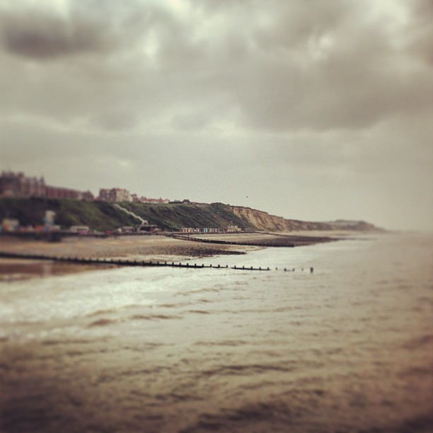 Teeny tiny beach huts. A view from the pier at Cromer.