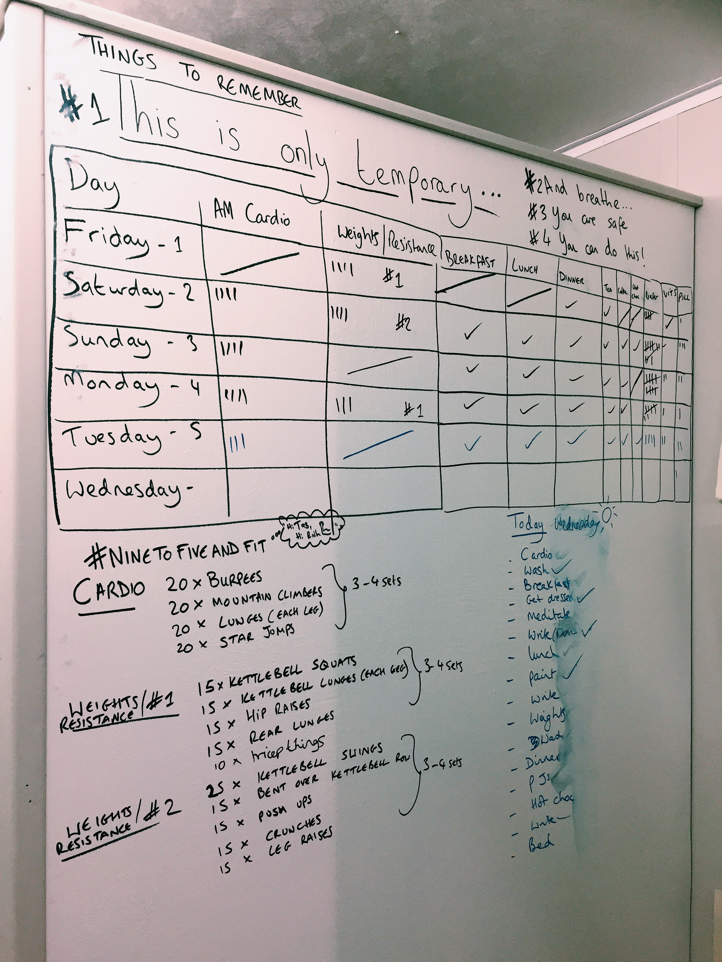 """My whiteboard. Exercises off my arm were transcribed asap, as soon as I got myself settled in """"the box"""" – this was to keep myself occupied (and sane) for the remainder of the challenge."""