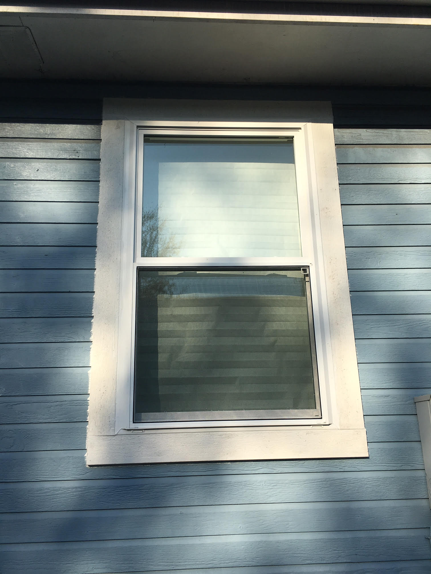 vinyl window replacement in masonite