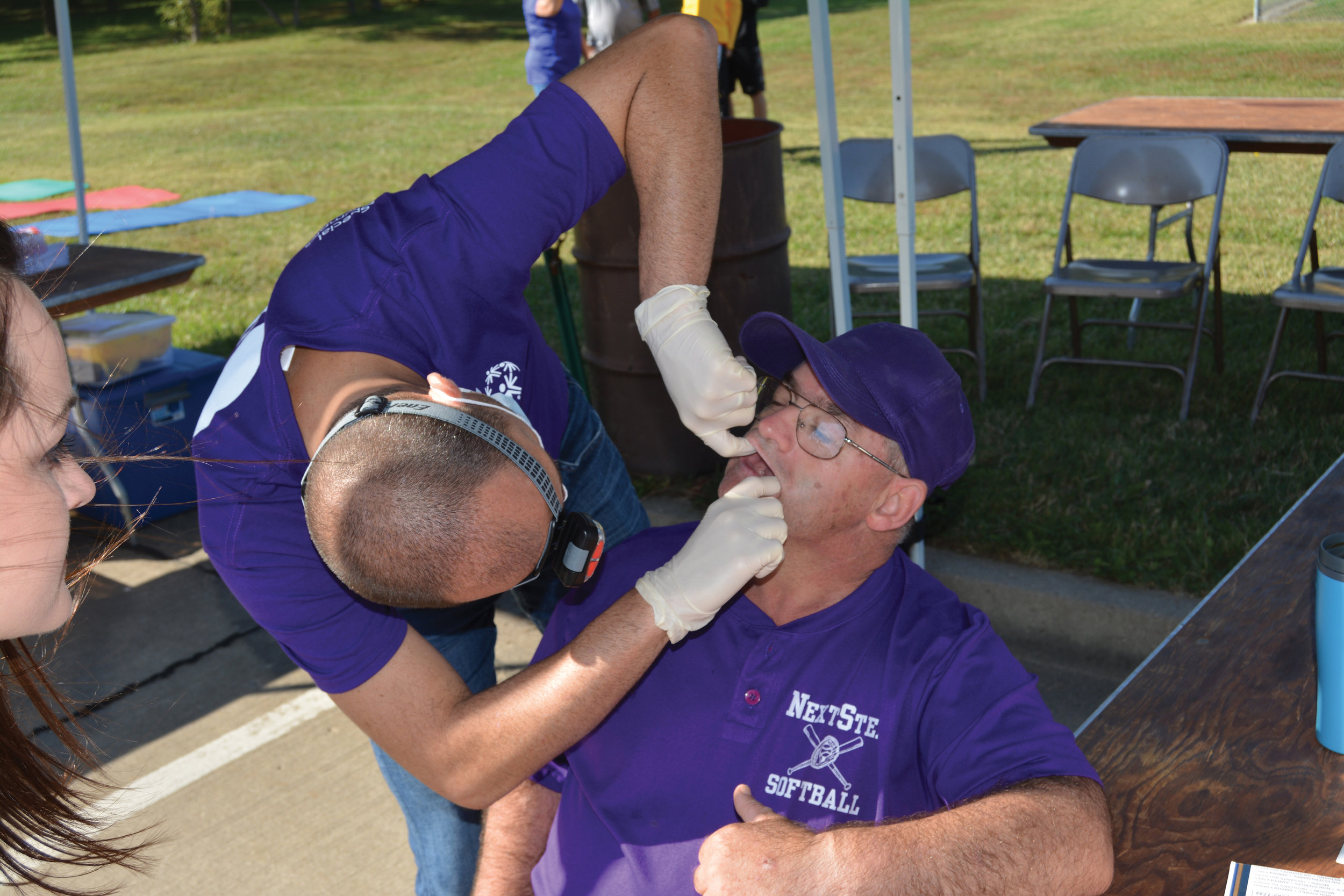 An athlete receives a free dental screening at State Outdoor Games