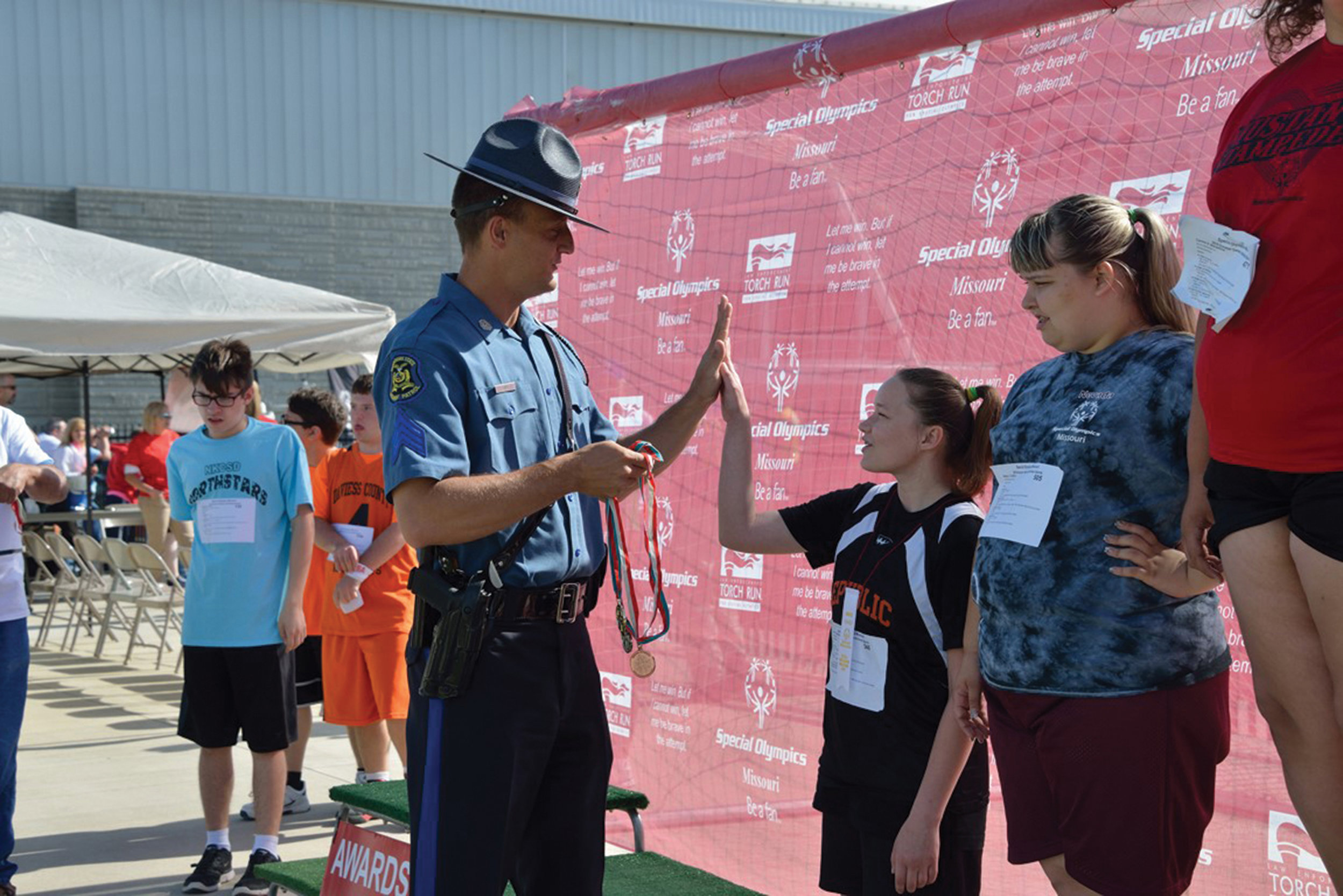 The only thing better than an award after competition may be a high-five from our friends in blue