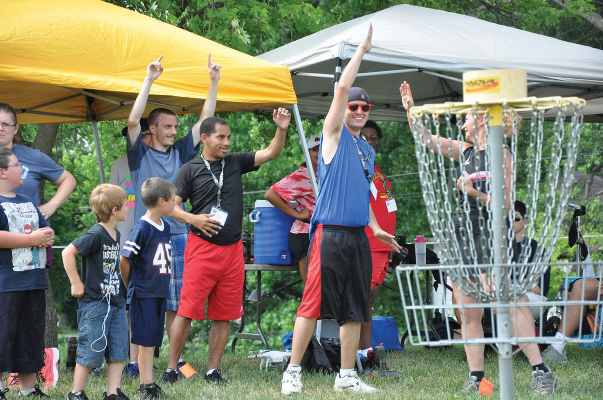 Celebrating a great disc golf throw during Sports Camp
