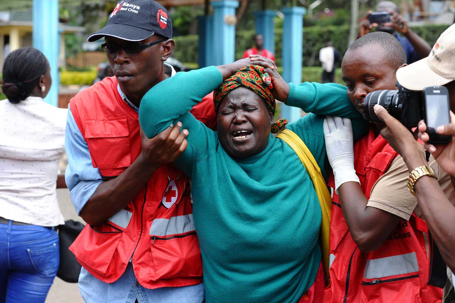 A woman is stricken with grief after the Garissa University College attack. The shockwaves led local communities to come together in rejecting further violence. Photo:Stringer/AP/REX/Shutterstock
