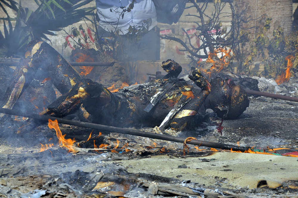 A burnt corpse near Nahda square, August 2013. Photo: Engy Imad/AFP/Getty Images