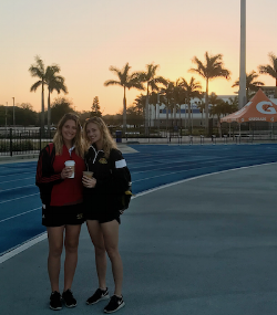 Myself (left) and Team Manager, Sarah Shepherd (right), admire the early sunrise at IMG Academy.