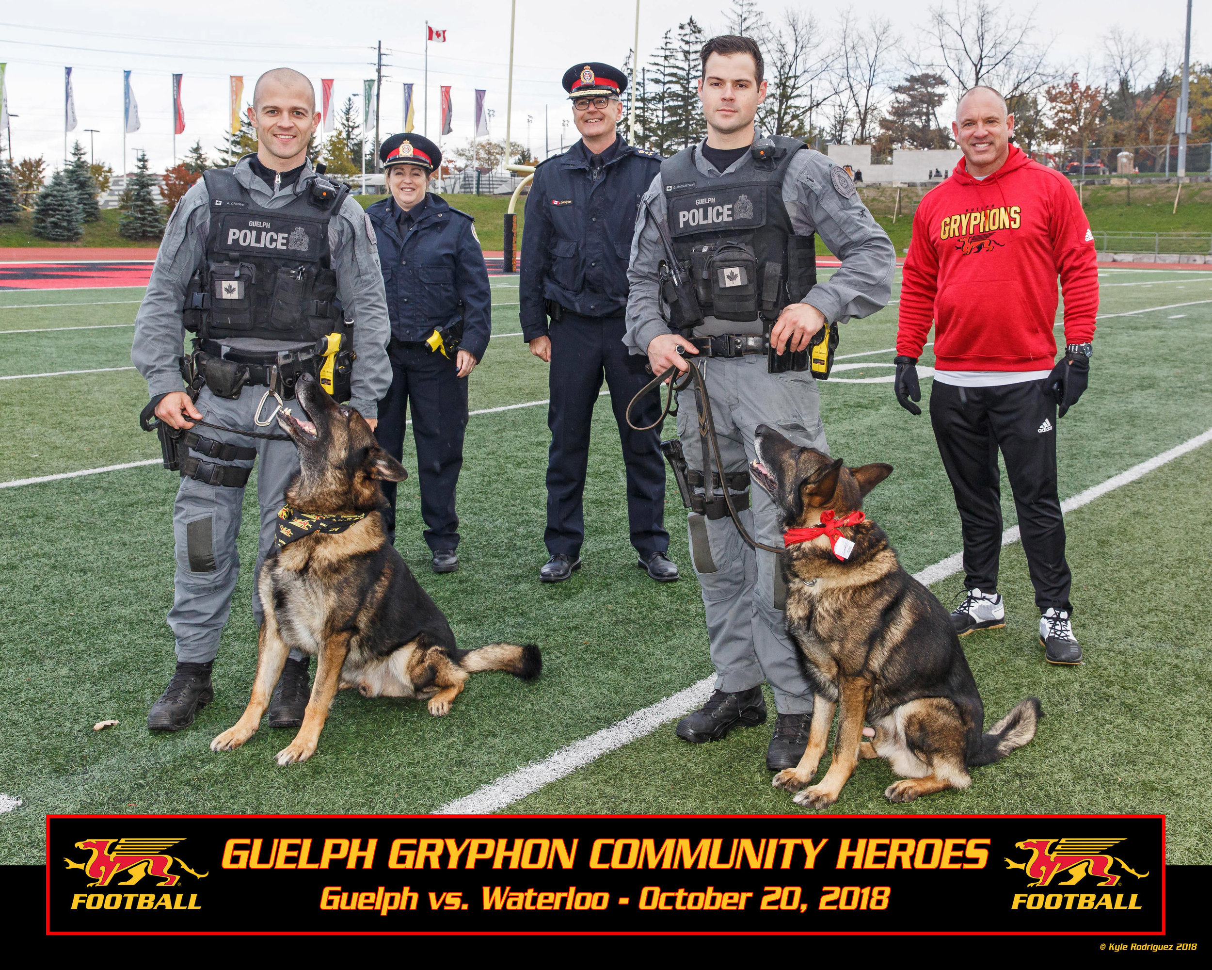 Left to right front: Cst. Andrew Crowe and Police Service Dog Charger, Cst. Greg McArthur and Police Service Dog General  Left to right rear: Inspector Andrea Ninacs, Chief Jeff DeRuyter, Doug Pflug (Gryphon Football)