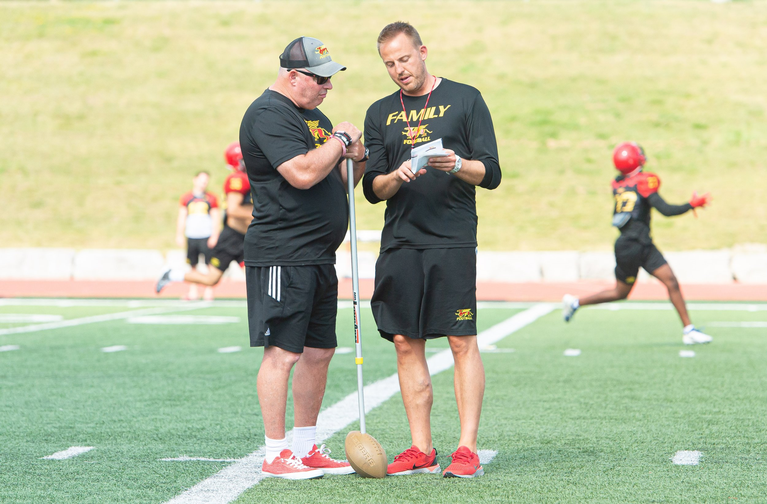 coach sheahan with defensive coordinator, dennis mcphee