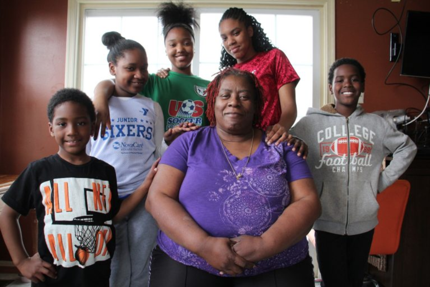 Octavia Durham is surrounded by five of the seven grandchildren who live with her and attend Pottsgrove Public Schools., (from left) Mason Dargan, 5, Tarienah Chandler Smith, 9, Miyana Francis, 14, K'Lliyah Smith, 15, and Mikhi Dargan, 9. (Emma Lee/WHYY)