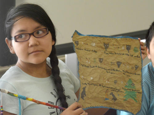 Sheiyann Thomas, 12, shares her story and art she made during the summer program's storytelling class.  Greg Sorber //Albuquerque Journal.