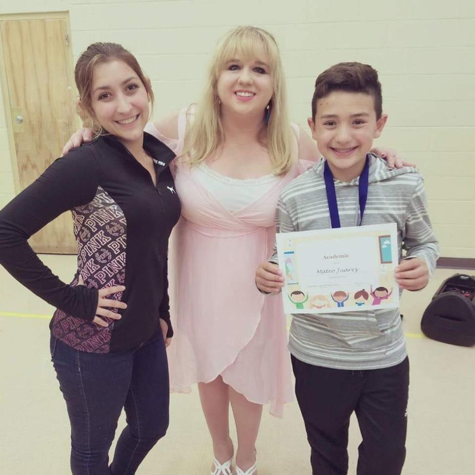 Elizabeth with students Camryn Juarez and Mateo Juarez