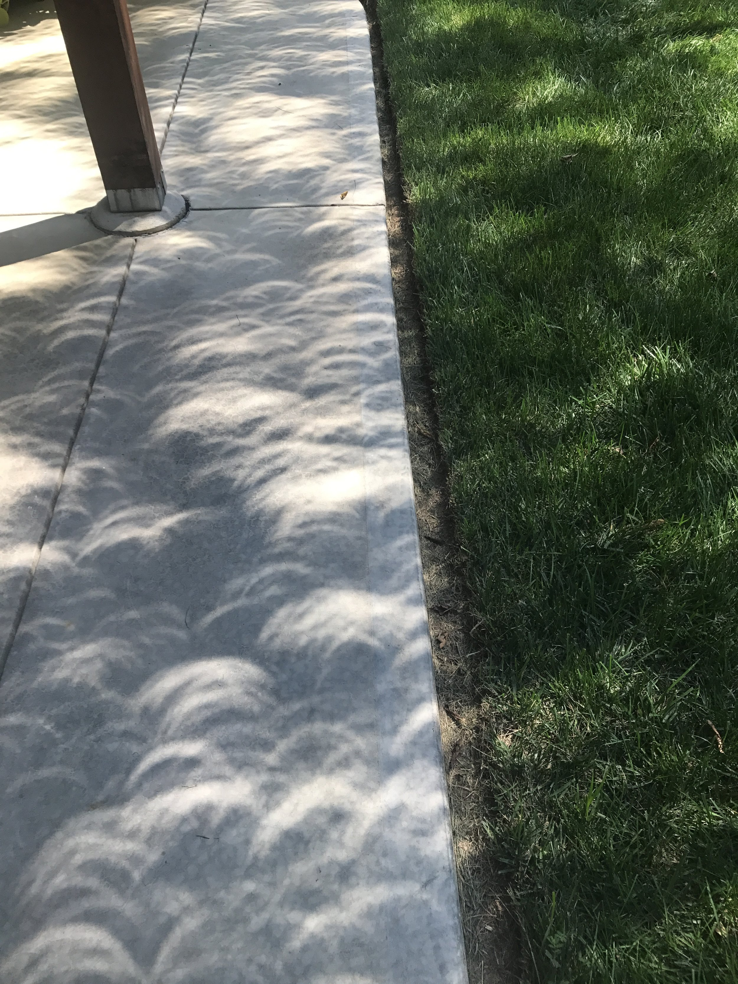 Crescent shaped shadows after totality