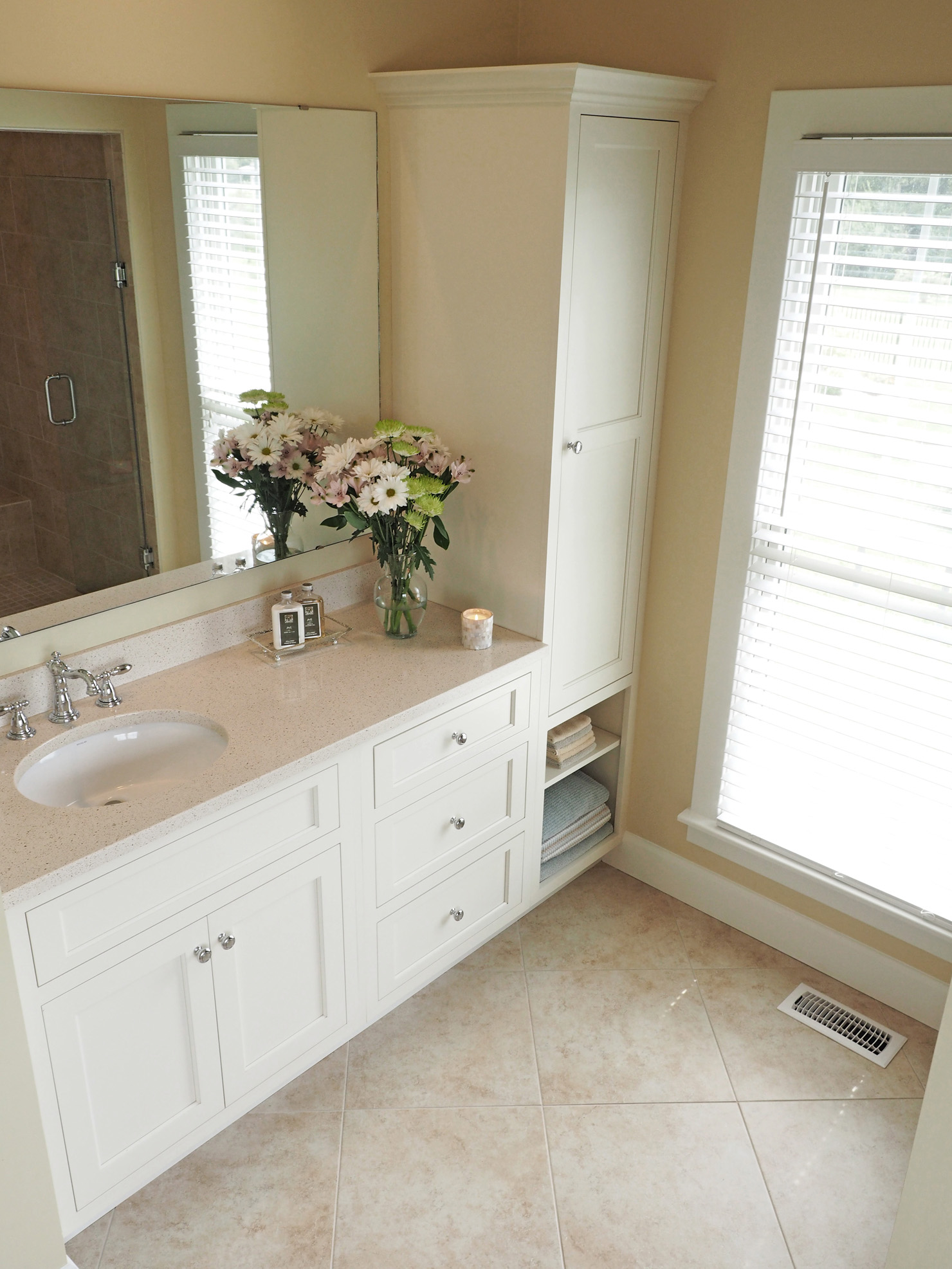 Previous paint color was Ivoire by Sherwin Williams. Our counter tops are Cambria Quartz and the name is Cardiff Cream.