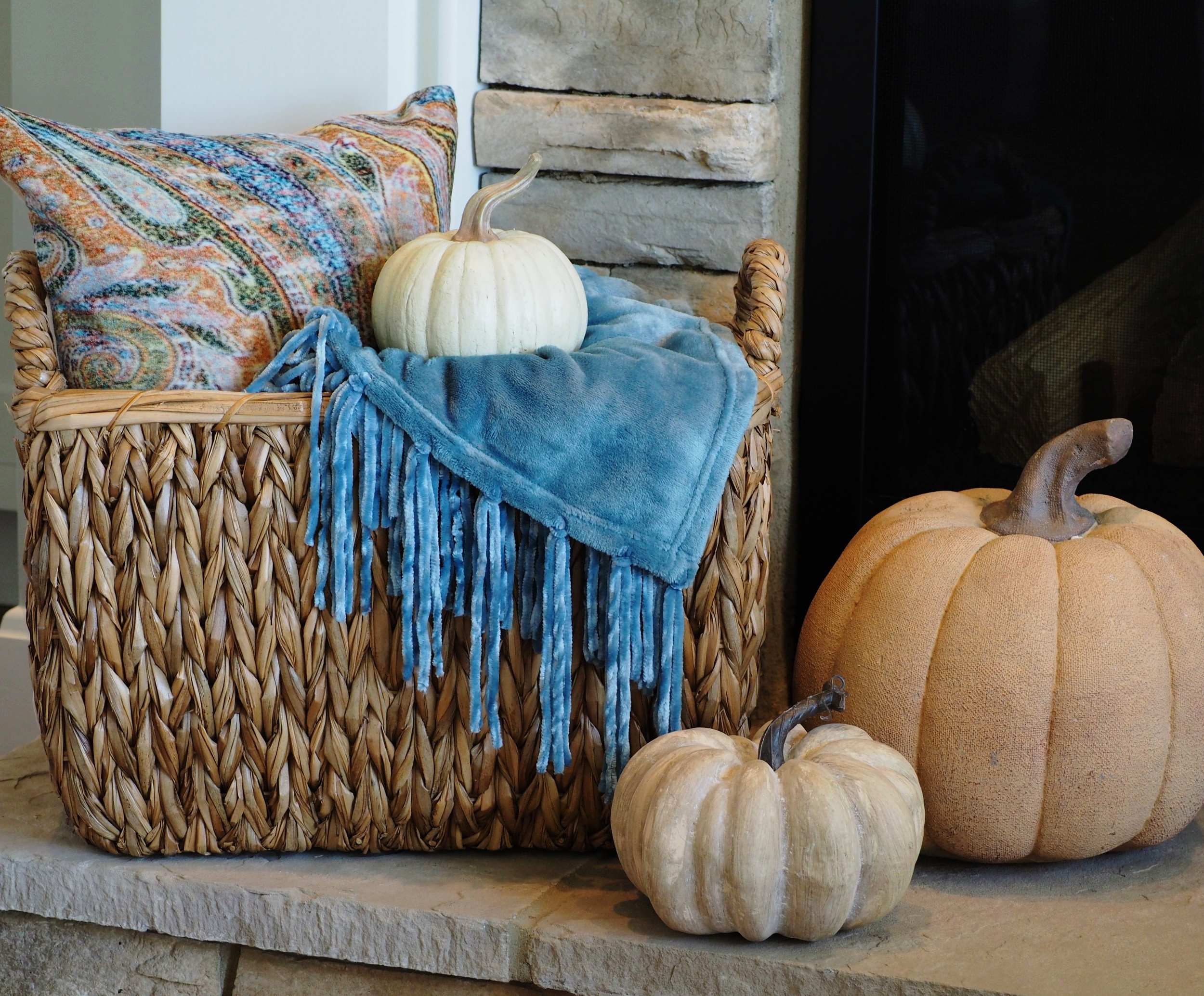 These were all new additions for my fall decor this year. I went out looking for some color and came home with this beautiful blue throw from Home Goods of course, it's pretty much my go to store for everything! The basket, gorgeous pillow and large, pale orange pumpkin were also found at Home Goods. The smaller pumpkins were purchased from Hobby Lobby.