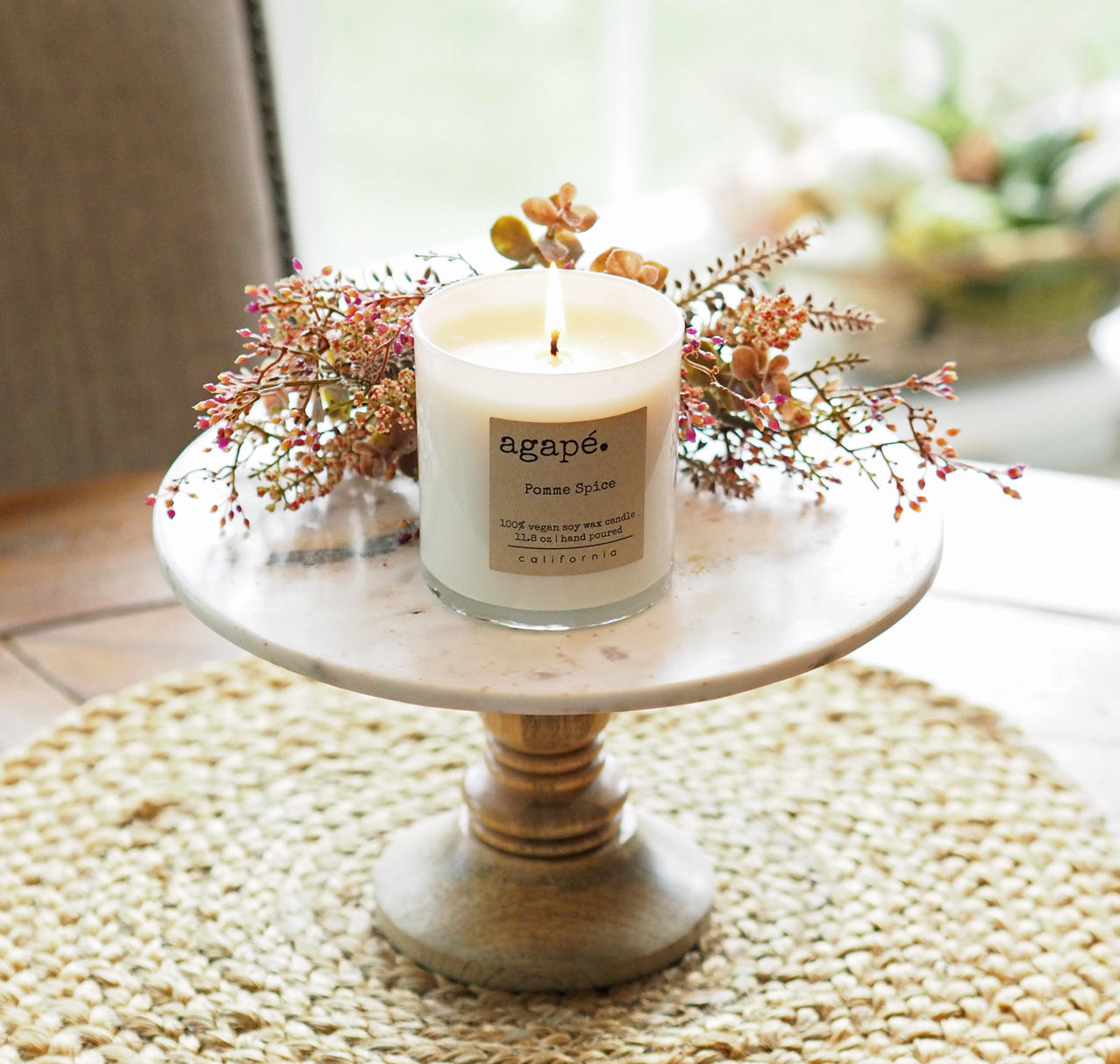 Marble  cakestand styled with that fabulous Pomme Spice Candle from  @AgapeCandles .The woven placemat is from Pier 1 Imports. Click  HERE for similar item.