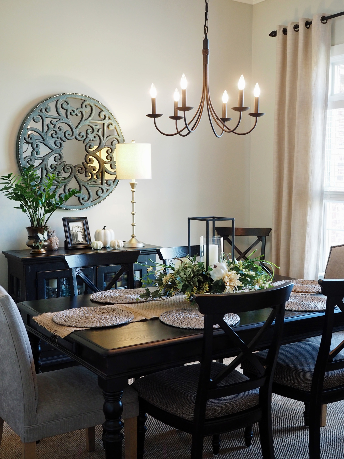 The formal dining room has maintained a fresh, neutral style for fall with bright green greenery and white pumpkins. Not many sources for this room because the mirror has been discontinued from Pier 1 Imports and the table and chairs are older and were purchased locally. The lamp is from Home Goods and the curtain panels are from  Pier 1 Imports .