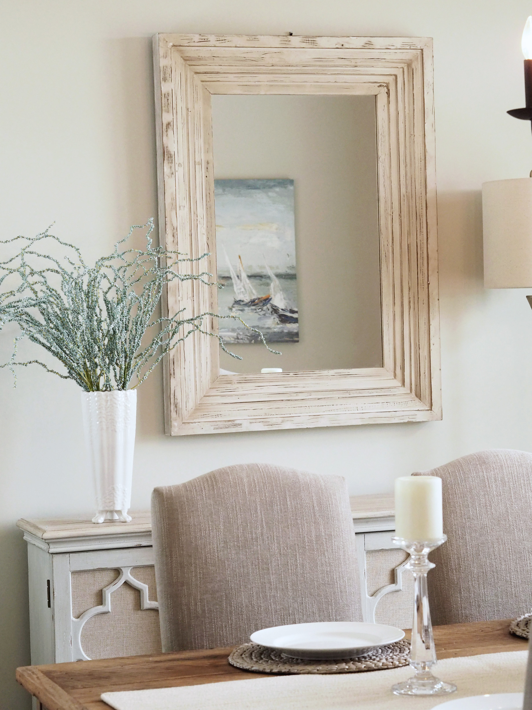 Perfect mirror which blends well with the rustic dining room table and the top surface of the buffet. This is the Bailey Farmhouse 30x40 mirror from  Pier 1 Imports.