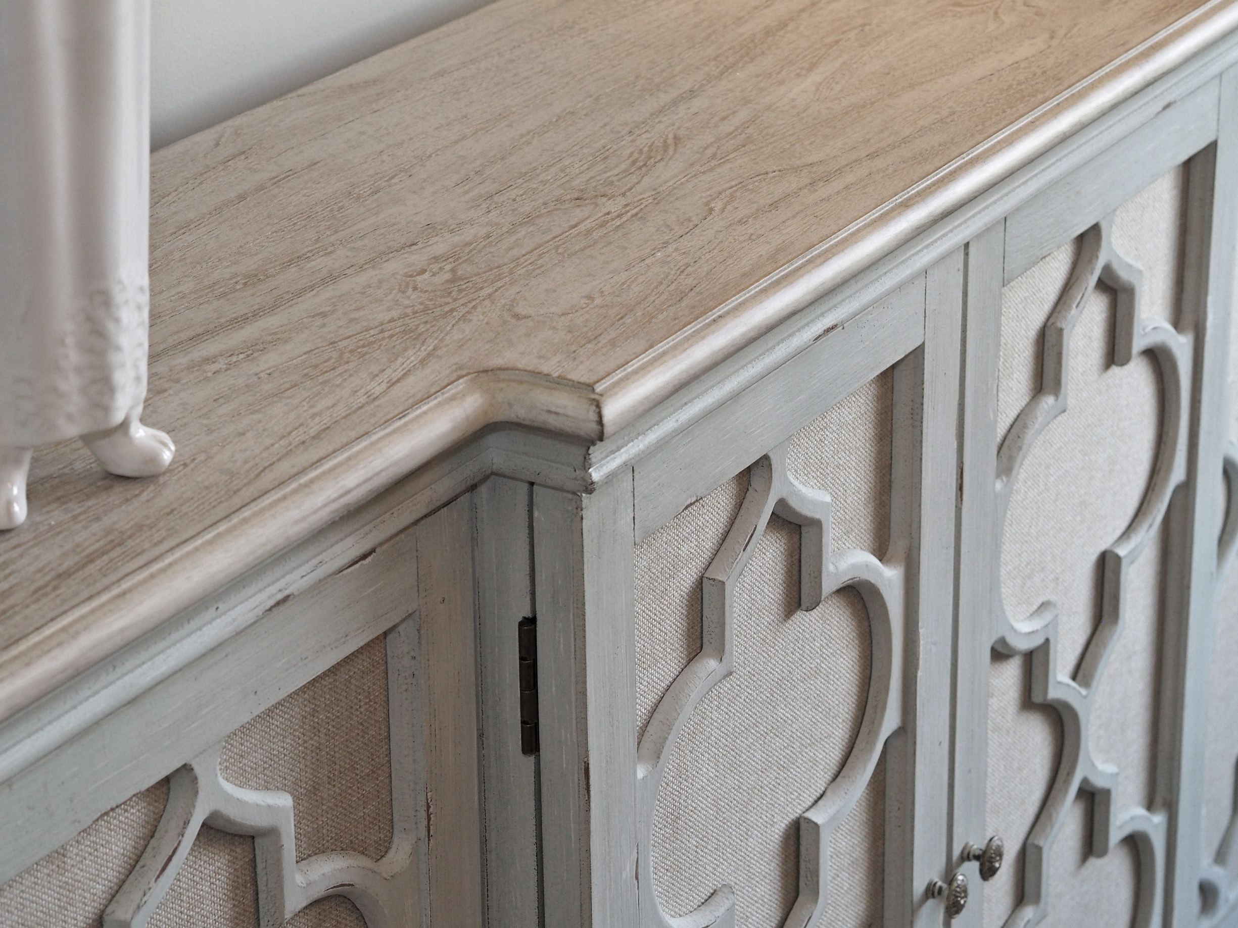 Close-up of the buffet to show details of the fabric front panels and the top.