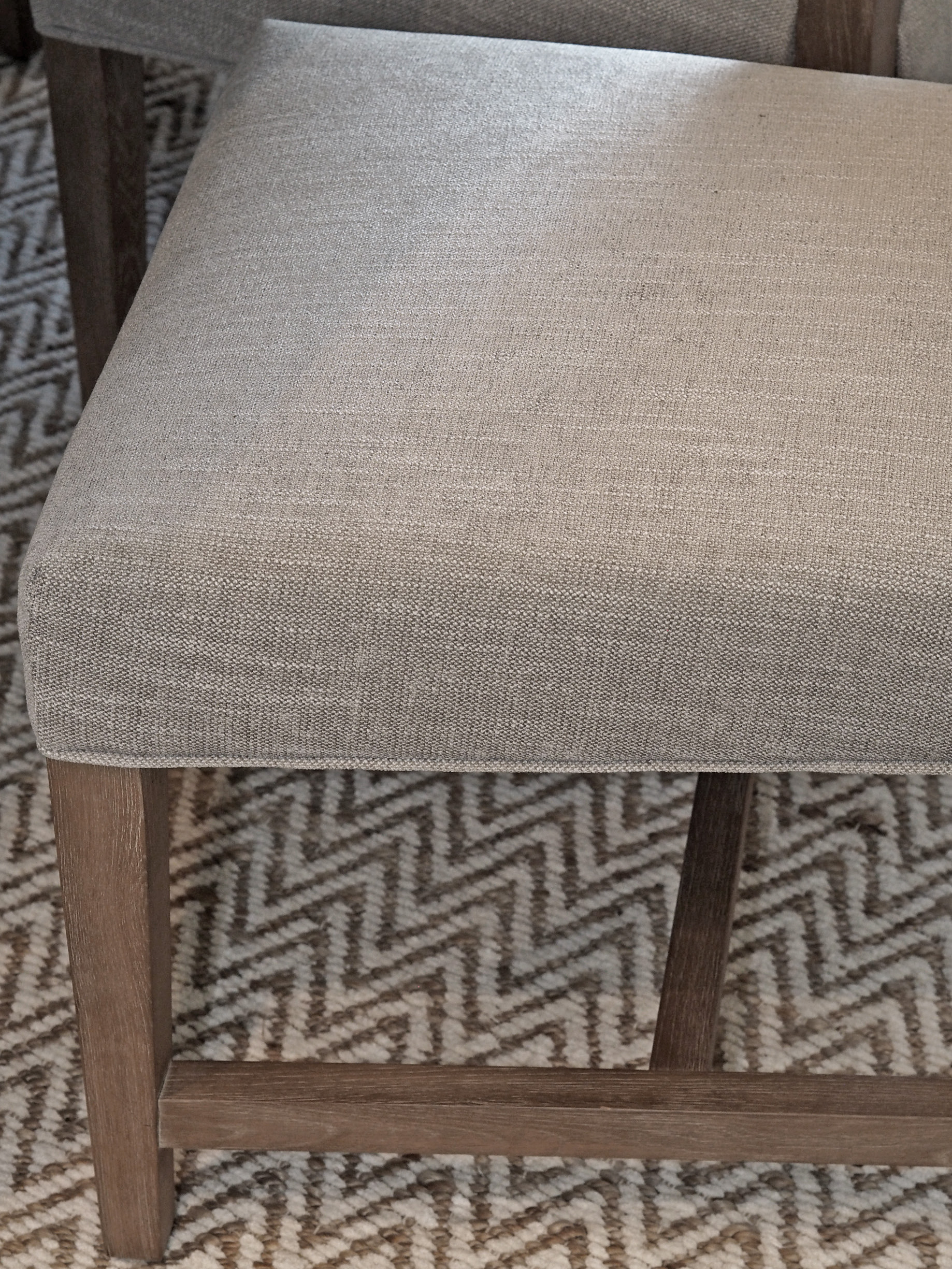 Pottery Barn Ashton Non-Tufted Dining Chairs in Silver Taupe. Showing the fabric and wood detail up-close. Honestly, these chairs are well worth the price! Incredibly sturdy and comfortable!