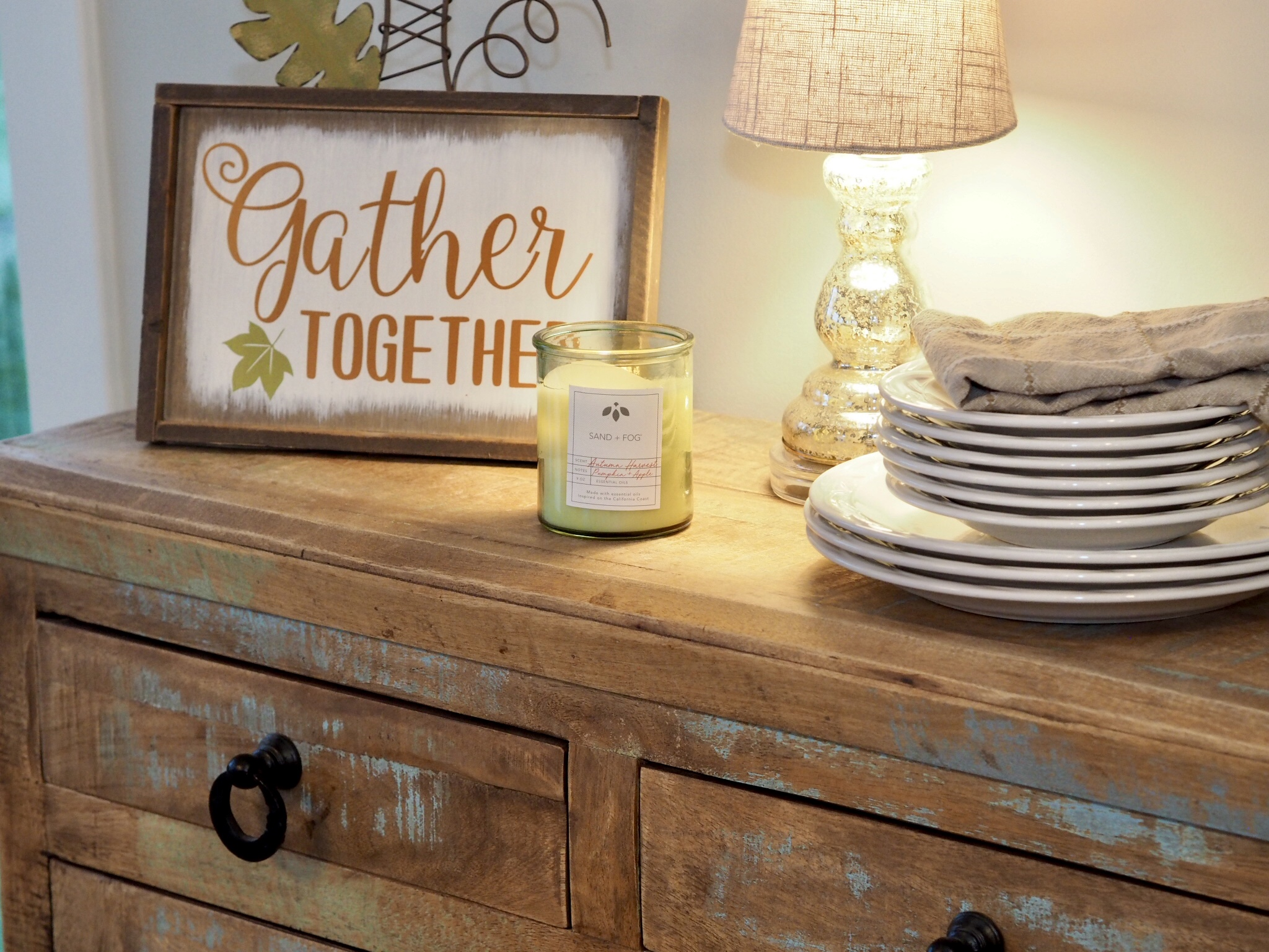 Gather Sign & lamp from Hobby Lobby. Chest from Home Goods.   Sand+Fog soy candle found at Home Goods. Sand+Fog are my favorite store bought candles.