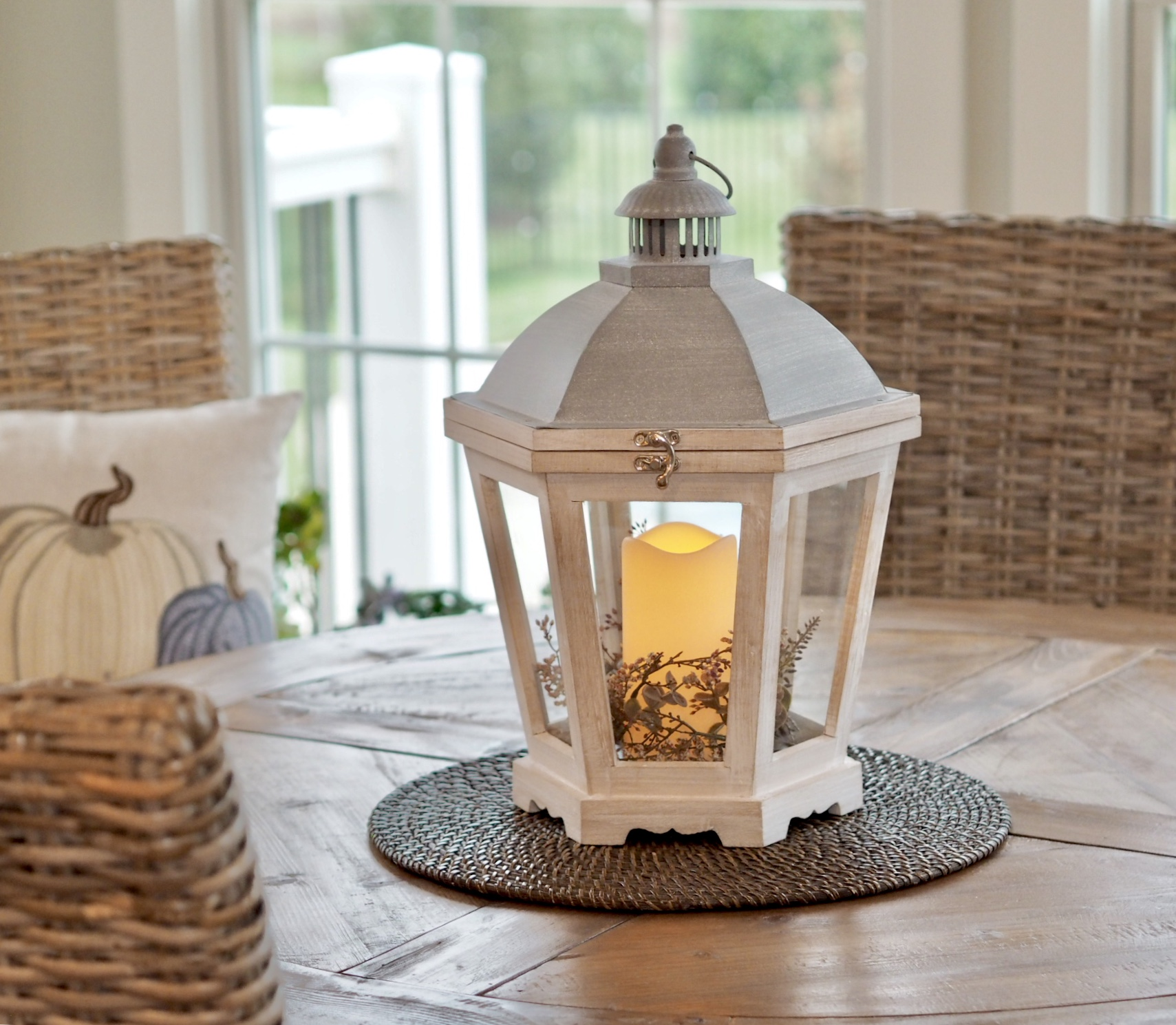 The cutest lantern with faux candle, the woven charger, the chairs and the pillow are from Pier 1 Imports.