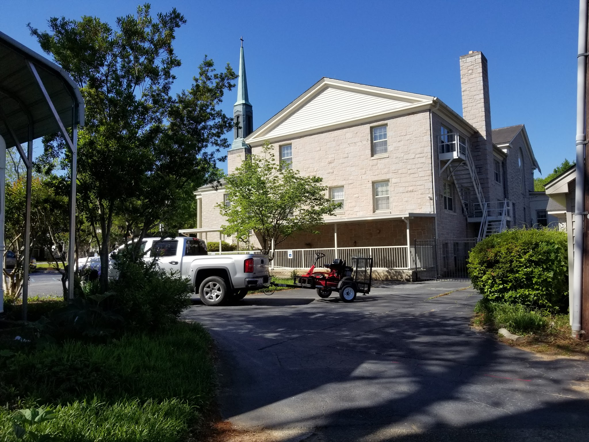 What does a picture of a lawnmower on a trailer have to do with Men's Ministry at Centennial ARP Church in Columbia, SC?