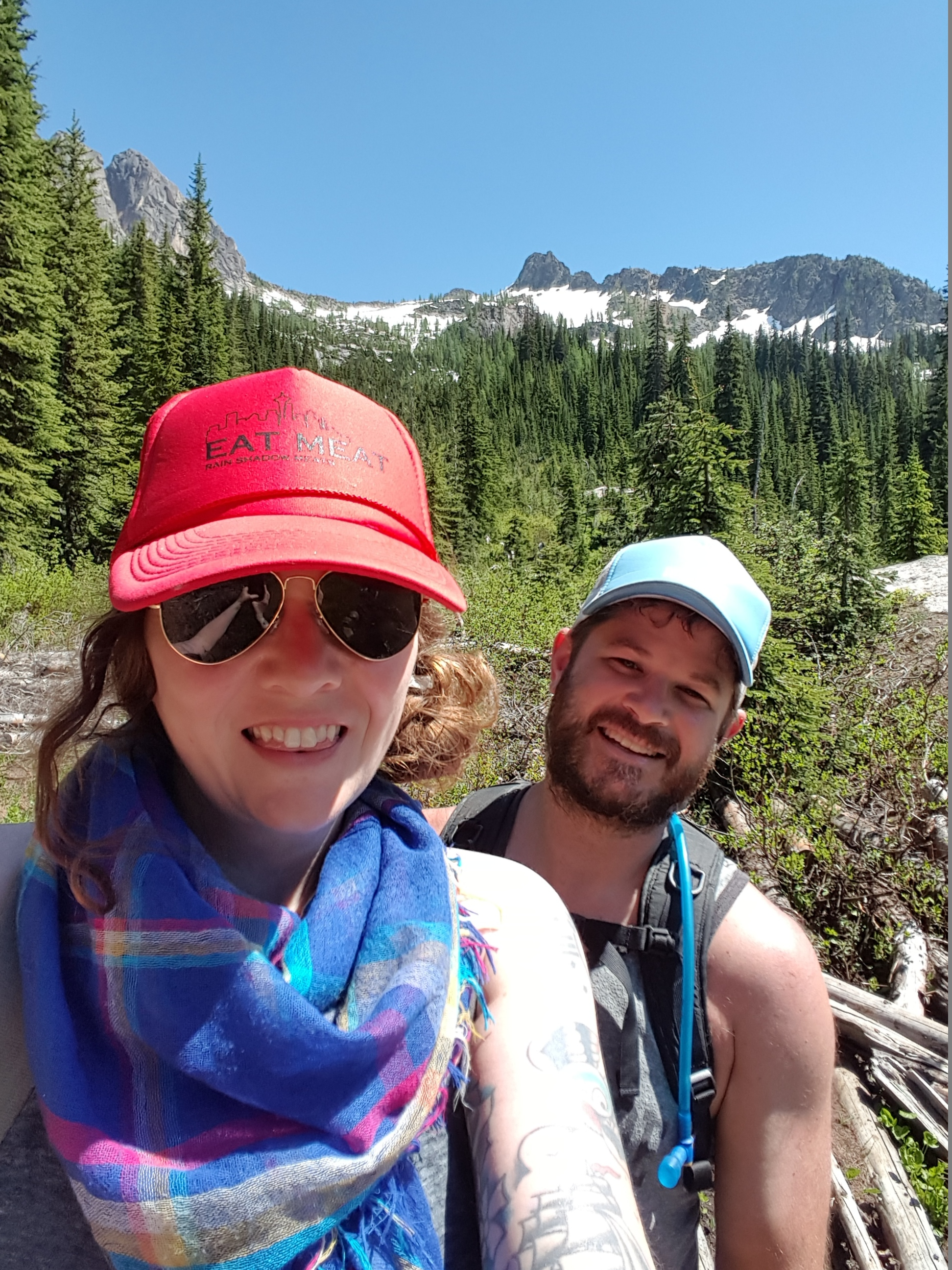 """Anna and Russ on a hike to Blue Lake, working for their fried chicken dinner! Anna is representing with her """"Eat Meat"""" hat."""