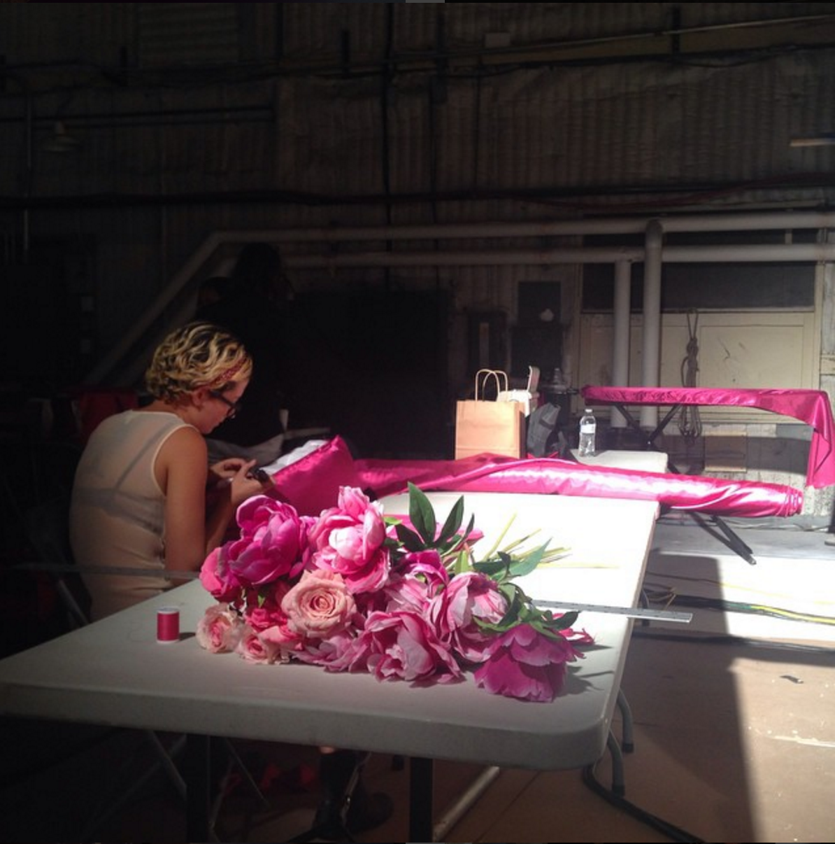 Like a Dutch still life, Maddie putting the finishing touches on our peonies before we make the bed of flowers after sourcing 6,000 beautiful silk peonies that then each needed to be hand sewn a point for attachment.