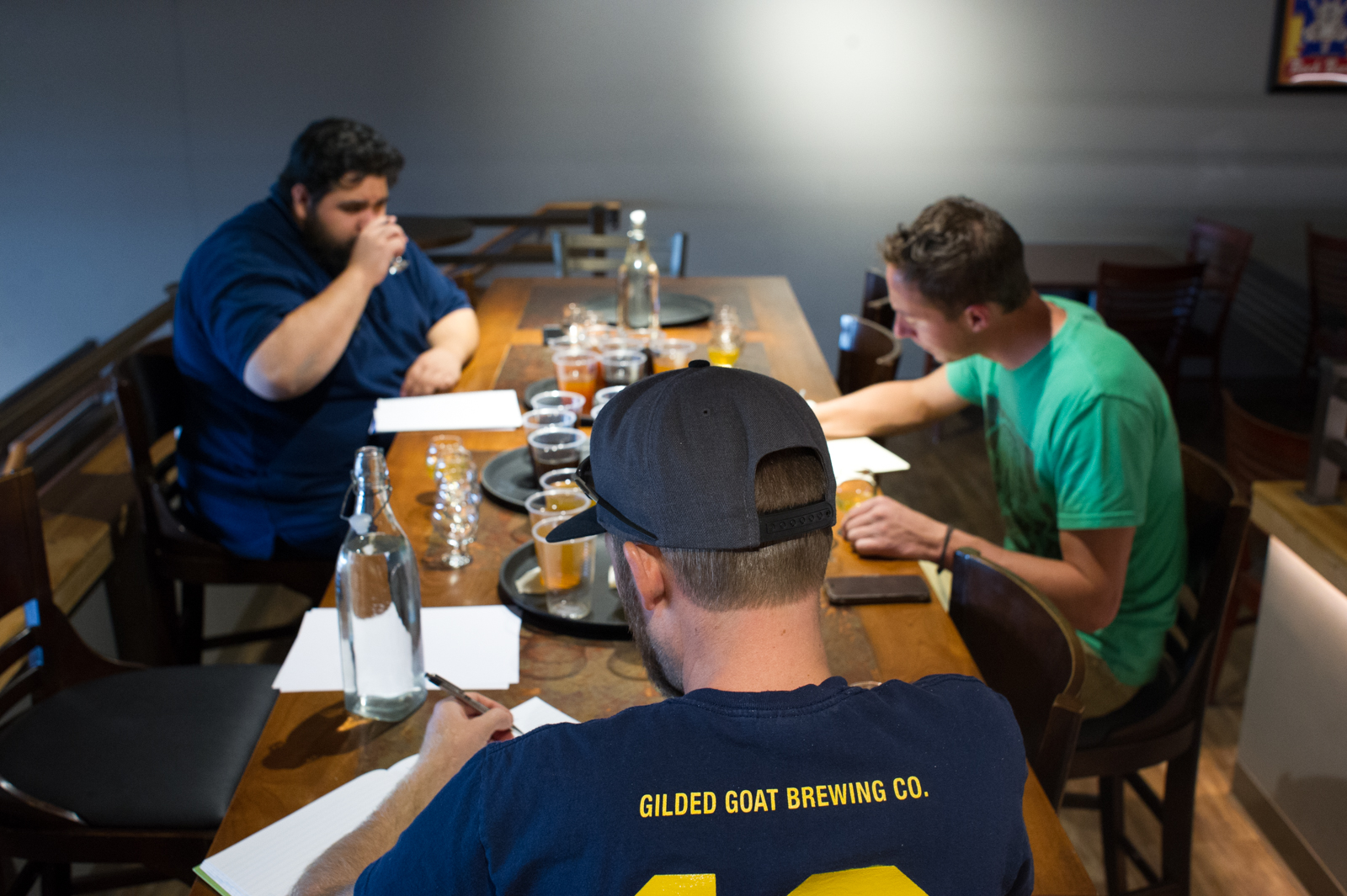 Brewmaster Charlie Hoxmeier leads the Gilded Goat team through tastings of our barrel aged beers - each at different maturation points.