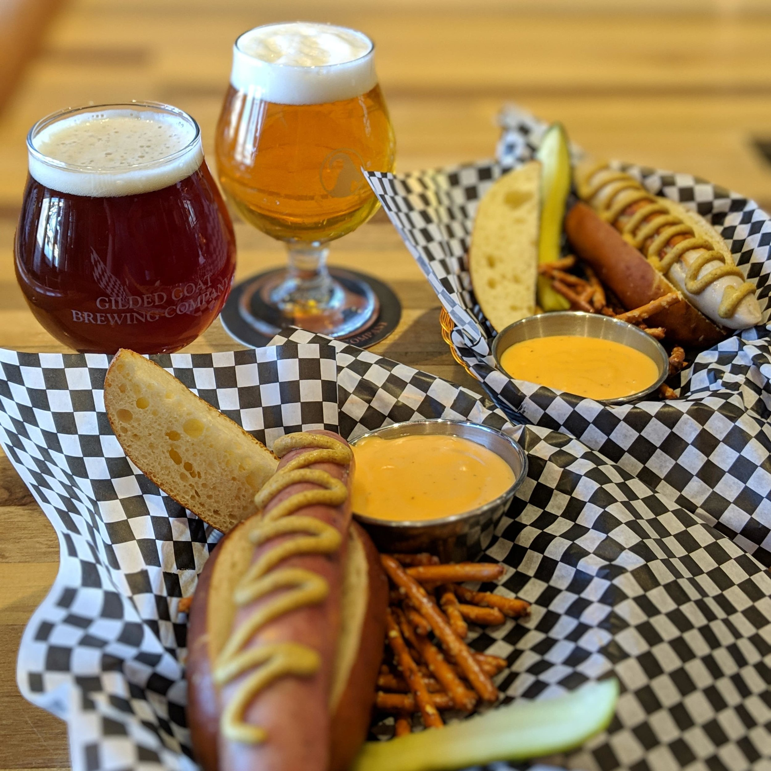 Lunch, Dinner, or snack, Gilded Goat Brewing Company has delicious food options. hot dogs, Hofmann Sausage Company. Beer Cheese. Pretzels. Craft beer. Snappy White, German Frank.