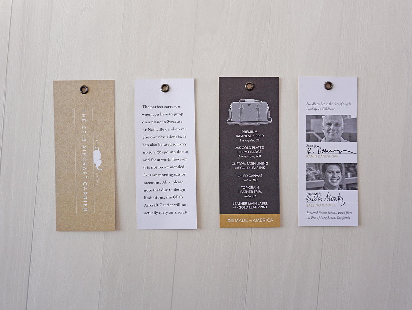 CUSTOM HANGTAGS WITH SPECIAL PANTONE GOLD INK AND ANTIQUE BRASS EYELETS. APPLIED WITH ROPE CORD.