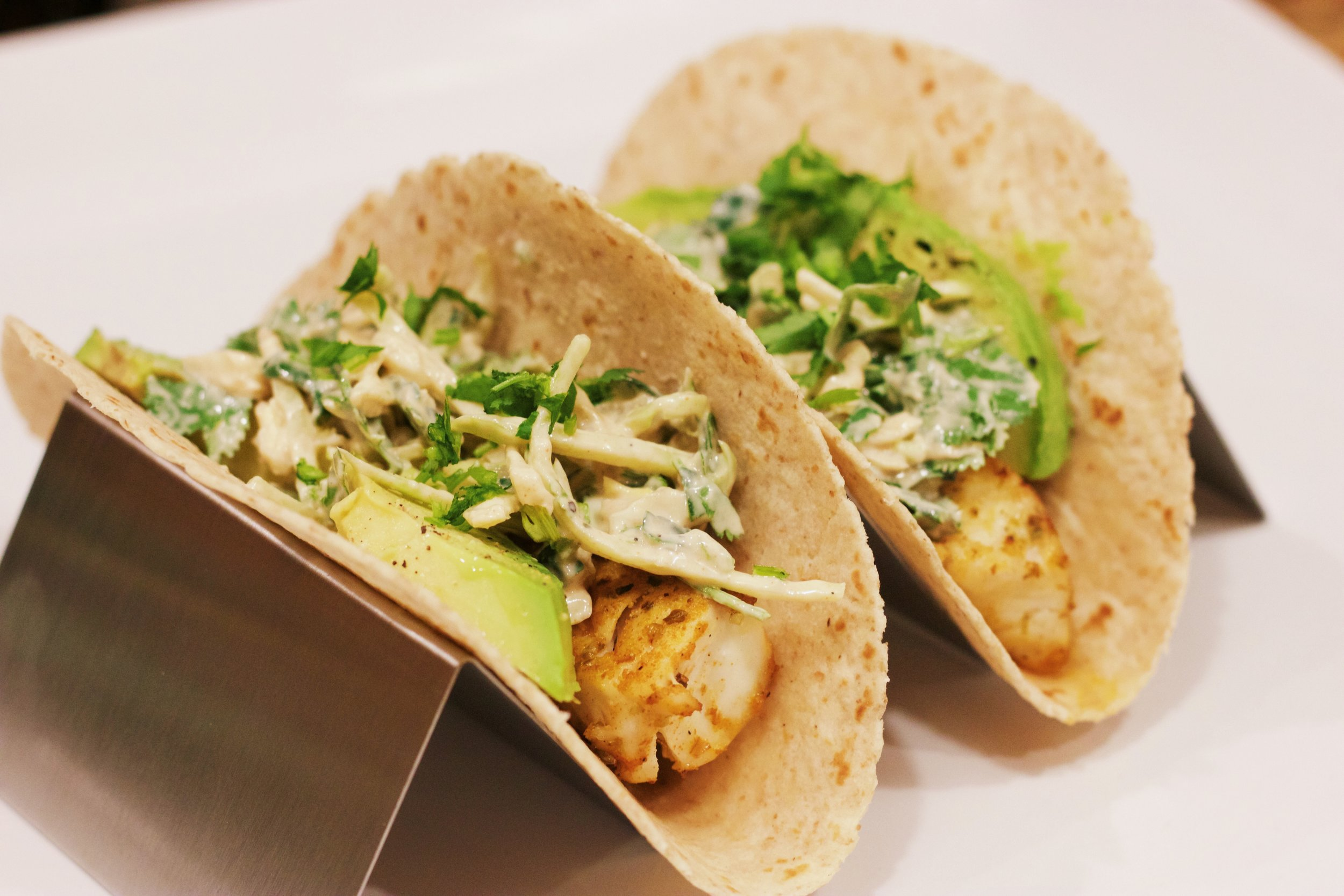 Quick and Healthy Tilapia Fish Tacos - These delicious fish tacos are ready in under 30 minutes and have less than 300 calories! They are a perfect weeknight meal! www.cardiocoffeeandkale.com