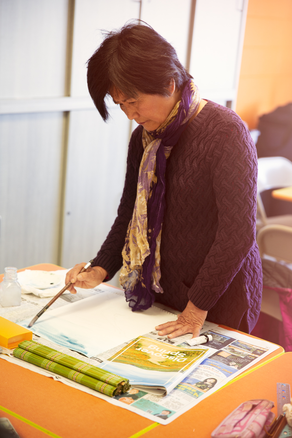 Senior Asian woman doing painting activity 1.jpg