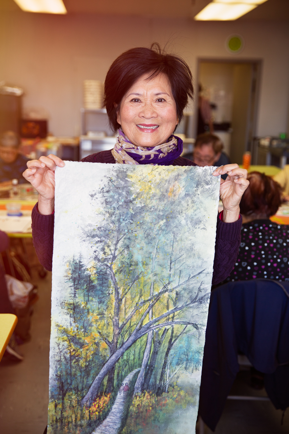Senior Asian woman doing painting activity 2.jpg