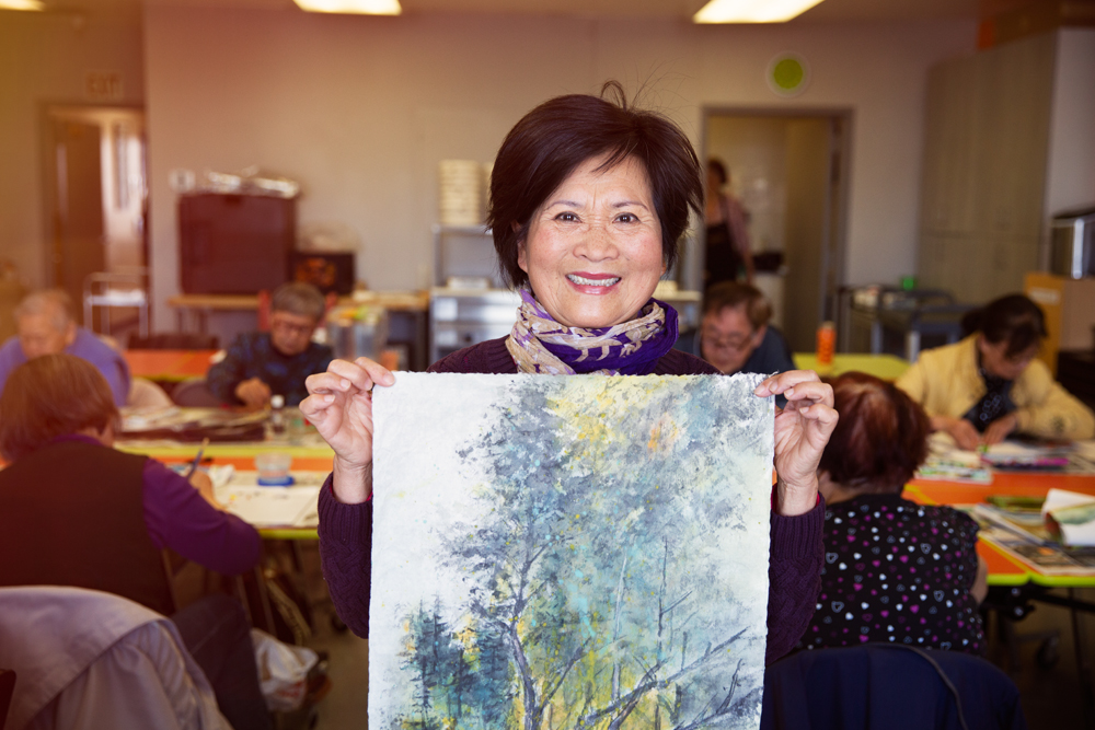 Senior Asian woman doing painting activity.jpg